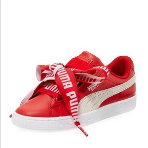 Red Puma basket heart shoes.